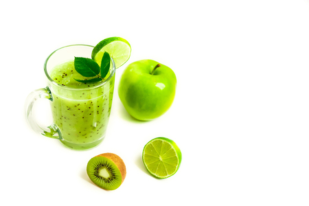 Green healthy cocktail of kiwi, green apple, lime and mint isolated on white background view of a crook Stock Photo