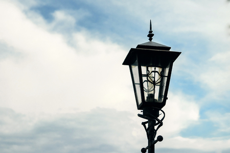 Antique Street Light isolated on a blue sky background. Stock Photo