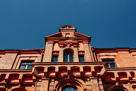 Facade of an old red brick building
