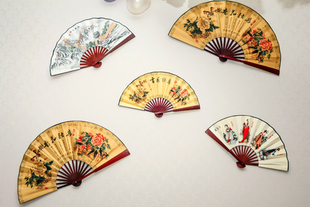 Japanese fan on the wall 写真素材