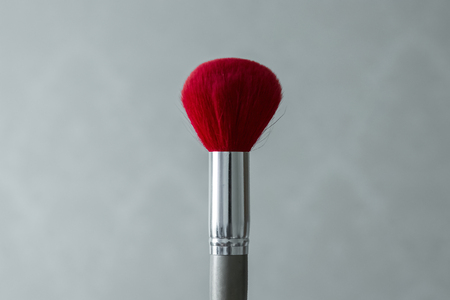 Red brush for powder close-up for make-up