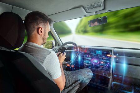 A man in an autonomous car. Self-driving. Concept autopilot, automotive engineering, artificial intelligence.