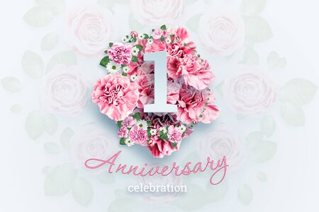 Creative background lettering 1 numbers and anniversary celebration text on pink flowers background. Anniversary concept, birthday, celebration event, template, flyer.