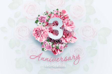 Creative background lettering 3 numbers and anniversary celebration text on pink flowers background. Anniversary concept, birthday, celebration event, template, flyer. Banco de Imagens