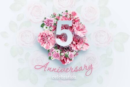 Creative background lettering 5 numbers and anniversary celebration text on pink flowers background. Anniversary concept, birthday, celebration event, template, flyer.
