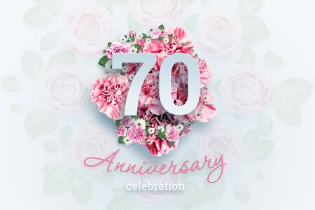 Creative background lettering 70 numbers and anniversary celebration text on pink flowers background. Anniversary concept, birthday, celebration event, template, flyer.