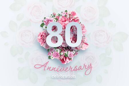 Creative background lettering 80 numbers and anniversary celebration text on pink flowers background. Anniversary concept, birthday, celebration event, template, flyer.