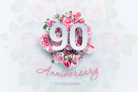 Creative background lettering 90 numbers and anniversary celebration text on pink flowers background. Anniversary concept, birthday, celebration event, template, flyer.