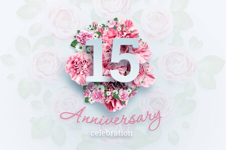 Creative background lettering 15 numbers and anniversary celebration text on pink flowers background. Anniversary concept, birthday, celebration event, template, flyer.