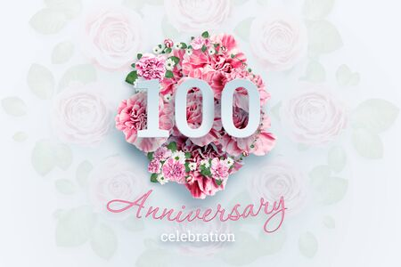 Creative background lettering 100 numbers and anniversary celebration text on pink flowers background. Anniversary concept, birthday, celebration event, template, flyer.