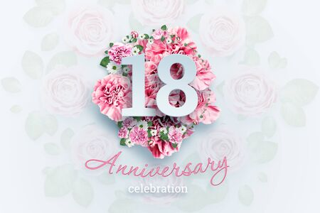 Creative background lettering 18 numbers and anniversary celebration text on pink flowers background. Anniversary concept, adulthood, birthday, celebration event, template, flyer.
