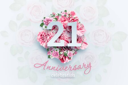 Creative background lettering 21 numbers and anniversary celebration text on pink flowers background. Anniversary concept, adulthood, birthday, celebration event, template, flyer.
