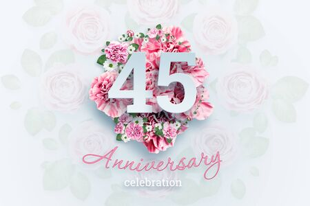 Creative background lettering 45 numbers and anniversary celebration text on pink flowers background. Anniversary concept, birthday, celebration event, template, flyer.