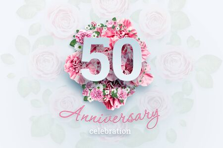 Creative background lettering 50 numbers and anniversary celebration text on pink flowers background. Anniversary concept, birthday, celebration event, template, flyer.
