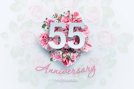 Creative background lettering 55 numbers and anniversary celebration text on pink flowers background. Anniversary concept, birthday, celebration event, template, flyer.