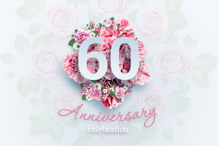 Creative background lettering 60 numbers and anniversary celebration text on pink flowers background. Anniversary concept, birthday, celebration event, template, flyer.