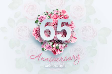 Creative background lettering 65 numbers and anniversary celebration text on pink flowers background. Anniversary concept, birthday, celebration event, template, flyer. Banco de Imagens