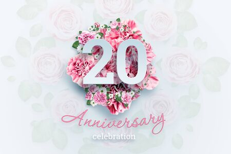 Creative background lettering 20 numbers and anniversary celebration text on pink flowers background. Anniversary concept, birthday, celebration event, template, flyer. Banco de Imagens