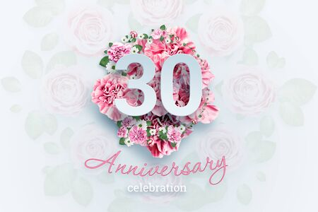 Creative background lettering 30 numbers and anniversary celebration text on pink flowers background. Anniversary concept, birthday, celebration event, template, flyer. Banco de Imagens