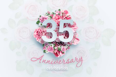 Creative background lettering 35 numbers and anniversary celebration text on pink flowers background. Anniversary concept, birthday, celebration event, template, flyer.