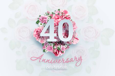 Creative background lettering 40 numbers and anniversary celebration text on pink flowers background. Anniversary concept, birthday, celebration event, template, flyer.
