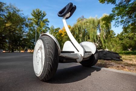 White hoverboard or self-balancing scooter in the park close-up. Фото со стока