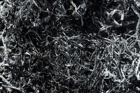 Gray background ashes, burned plants, abstract texture of coals and ashes. Macro shot