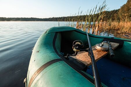 Inflatable boat on the lake at sunrise. Фото со стока