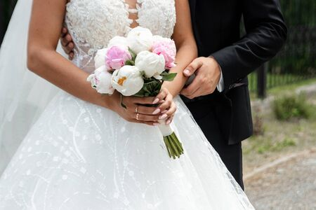 Wedding series 25. Wedding bouquet from colorful roses in hand of the bride