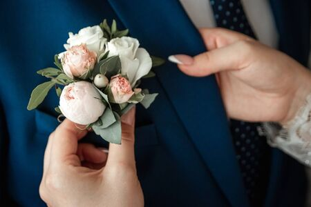 Boutonniere for the groom. The concept of marriage, family relationships, wedding paraphernalia