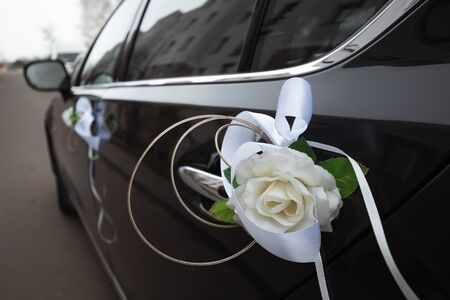 Wedding decoration on cars. The concept of marriage, family relationships, wedding paraphernalia