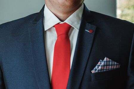 Hands of a businessman, close-up, tie, bow tie.