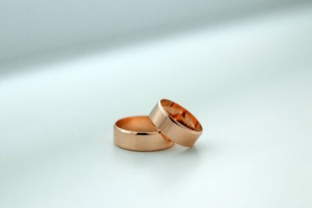Gold wedding rings. The concept of marriage, family relationships, wedding paraphernalia