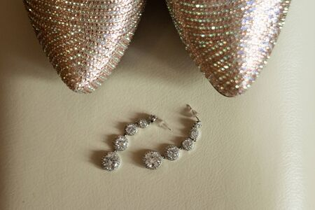 composition - wedding shoes with decor and accessories. The concept of marriage, family relationships, wedding paraphernalia