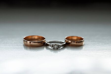 Gold wedding rings. The concept of marriage, family relationships, wedding paraphernalia Stock Photo