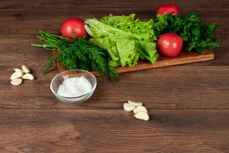 Ingredients for making salad, fresh vegetables on a wooden background Stock Photo