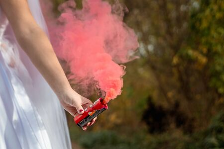 bride hold smoke bomb in his hands, the concept of family relationships, wedding paraphernalia