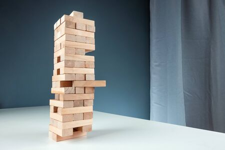 Column game . The concept of a mortgage, investment risks, economic crisis, economic instability Archivio Fotografico