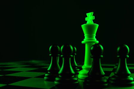 Close-up hand makes a pawn move, chess, chessboard, game, confrontation