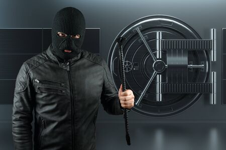 Masked burglar with crowbar in the background. Bank vault doors, large safe, bank robbery. The concept of deposit protection, protection of savings. Copy space, mixed medi
