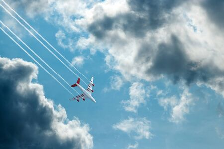 Passenger plane, airliner on a background of blue sky bottom view. The concept of air travel, travel. Copy space