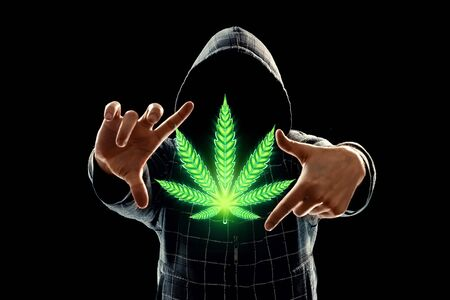 Male hands with marijuana sign, hemp leaf, cannabis consumer symbol. The concept of legalization of marijuana medical use, the impact on the psyche. Copy space Banque d'images