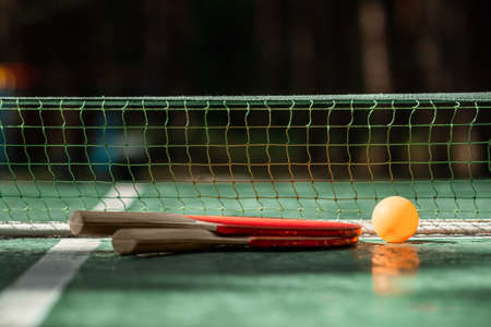 The concept of sports games, healthy lifestyle. Rackets for for table tennis and orange balls. Copy space, soft focus Foto de archivo