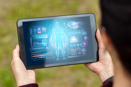 Close-up of a tablet in hands depicting a medical technology hologram graphics. medicine of modern times. Copy space 스톡 콘텐츠
