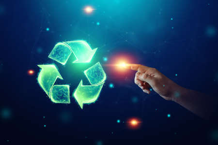 Recycling hologram sign on a blue background. Green eco recycling symbol and human hand. The concept of clean land, garbage disposal