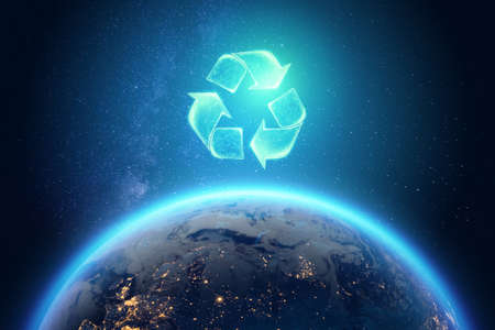 Recycling. Eco recycling green symbol. Recycling sign on the background of the globe 스톡 콘텐츠