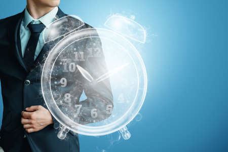 Time management concept, businessman next to the clock hologram. Hourly poes, passage of time, dead line. Copy space