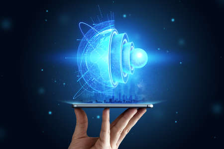blue hologram Internal structure of the earth above the tablet, the structure of the core, geological layers. Earth geology concept, new technologies. Banco de Imagens