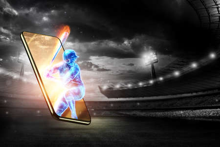 A silhouette, an image of a baseball player with a bat on fire crawls out of a smartphone, a hologram. Online sports concept, betting, American game Stock Photo