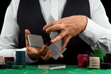 Male hands croupier shuffles cards close-up. Casino concept, gambling, blackjack